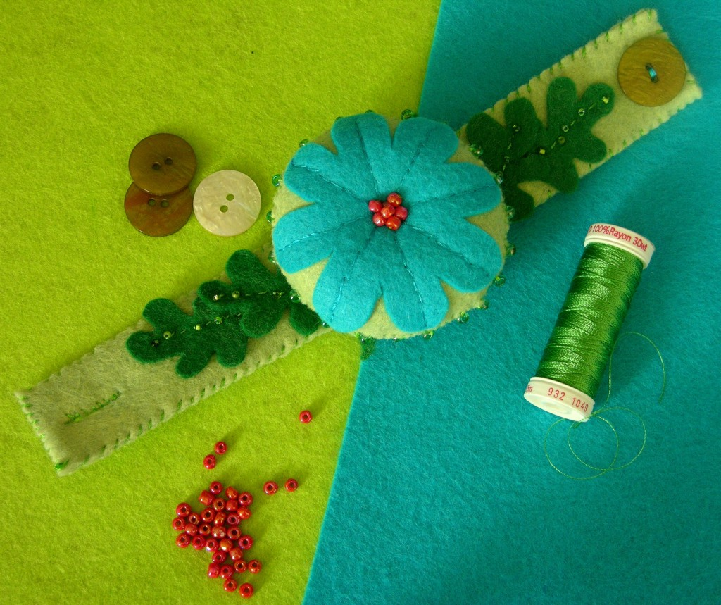 blue and green wrist pincushion with some beads